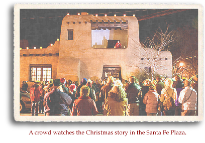 A crowd watches the Christmas story in the Santa Fe Plaza.